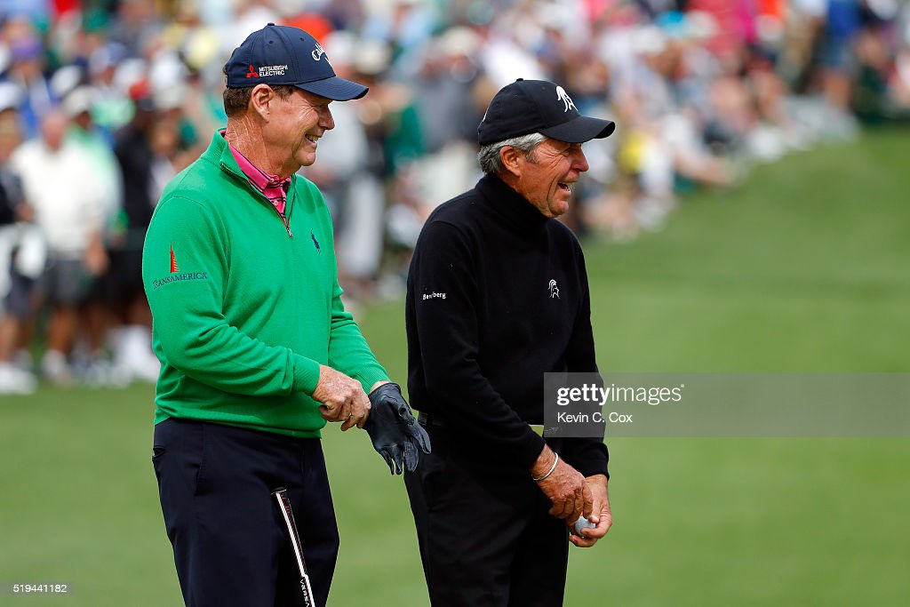 Gary Player celebrates with Tom Watson of the United States after hitting a hole in one on the seventh hole during the Par 3 Contest prior to the start of the 2016 Masters Tournament at Augusta National Golf Club on April 6, 2016 in Augusta, Georgia.