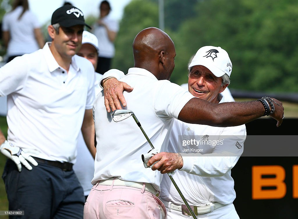 Gary Player embraces DJ Spoony during the Gary Player Invitational Europe 2013 at Wentworth Golf Club on July 22, 2013 in Virginia Water, England.