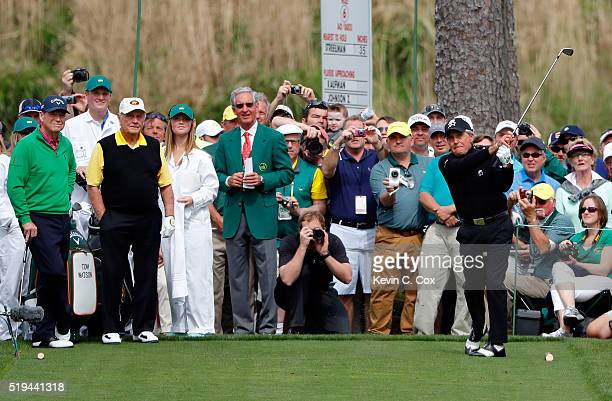 Gary Player hits a hole in one on the seventh hole as Tom Watson of the United States and Jack Nicklaus look on during the Par 3 Contest prior to the...