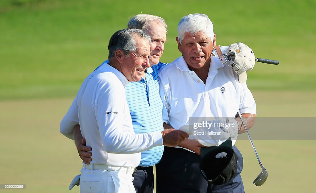 Gary Player Jack Nicklaus and Lee Trevino pose together on the final green during the 3M Greats of Golf during the second round of the Insperity...