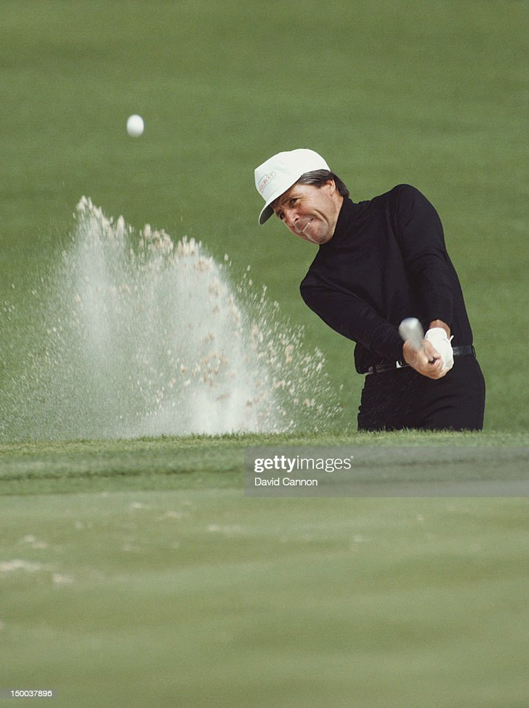 <a gi-track='captionPersonalityLinkClicked' href=/galleries/search?phrase=Gary+Player&family=editorial&specificpeople=203189 ng-click='$event.stopPropagation()'>Gary Player</a> of South Africa chips out of the sand bunker on 12th April 1984 during the US Masters Golf Tournament at the Augusta National Golf Club in Augusta, Georgia, United States.