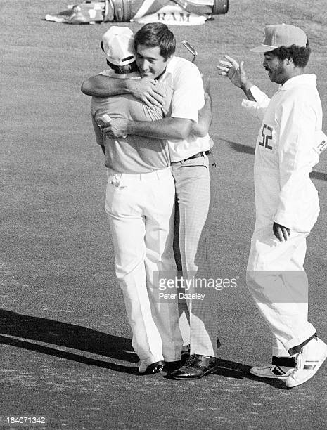 Gary Player of South Africa is embraced by his playing partner Severiano Ballesteros of Spain after he had holed his winning putt on the 18th green...