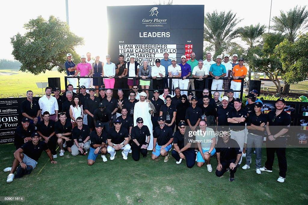 Gary Player of South Africa is joined by professional and amateur competitors after the Gary Player Invitational Abu Dhabi at Saadiyat Beach Golf Club on February 8, 2016 in Abu Dhabi, United Arab Emirates.