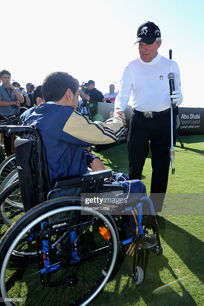Gary Player of South Africa shakes hands with a youngster from the Zayed Higher Organization and Rehabilitation Centre during a golf clinic ahead ofthe Gary Player Invitational Abu Dhabi at Saadiyat Beach Golf Club on February 8, 2016 in Abu Dhabi, United Arab Emirates.