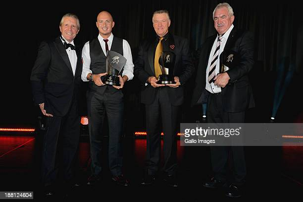 Gary Player poses with the winning four ball team Herschelle Gibbs Chris Potgieter and Harry Rossouw during the Gala Dinner and Charitable Auction of...
