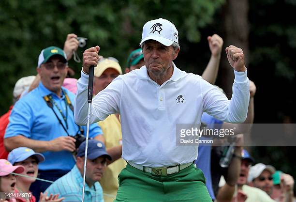 Gary Player reacts after sinking a birdie putt on the first hole during the Par 3 Contest prior to the start of the 2012 Masters Tournament at...