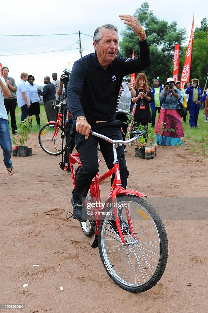 Gary Player rides one of the bicycles during the charity visit on day 2 of the Gary Player Invitational presented by Coca Cola from Osindisweni on November 22, 2012 in KwaZulu Natal, South Africa.