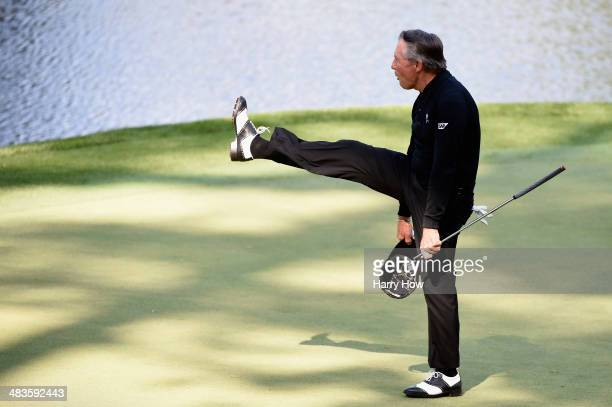 Gary Player salutes the gallery on the ninth green during the 2014 Par 3 Contest prior to the start of the 2014 Masters Tournament at Augusta...