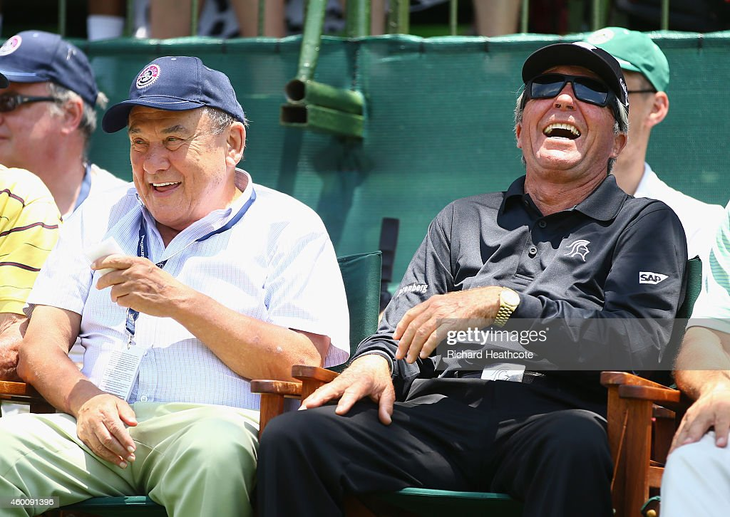 Gary Player shares a joke with Sun City creator Sol Kerzner as they watch from the first tee during the final round of the Nedbank Golf Challenge at...