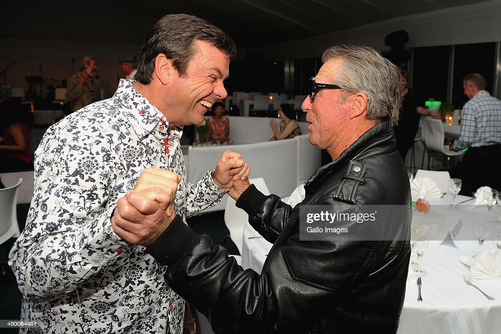 <a gi-track='captionPersonalityLinkClicked' href=/galleries/search?phrase=Gary+Player&family=editorial&specificpeople=203189 ng-click='$event.stopPropagation()'>Gary Player</a> (R) shares ajoke with auctioneer Iain Banner during the Saturday Night Party of the <a gi-track='captionPersonalityLinkClicked' href=/galleries/search?phrase=Gary+Player&family=editorial&specificpeople=203189 ng-click='$event.stopPropagation()'>Gary Player</a> Invitational presented by Coca-Cola at <a gi-track='captionPersonalityLinkClicked' href=/galleries/search?phrase=Gary+Player&family=editorial&specificpeople=203189 ng-click='$event.stopPropagation()'>Gary Player</a> Country Club on November 16, 2013 in Sun City, South Africa.