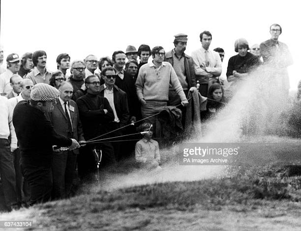 Gary Player spreads the sand as he plays out of a bunker