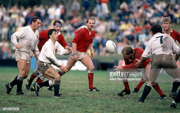 Gary Rees of England receives a pass from teammate Richard Harding backed up by Brian Moore during the Rugby World Cup Quarterfinal match between...