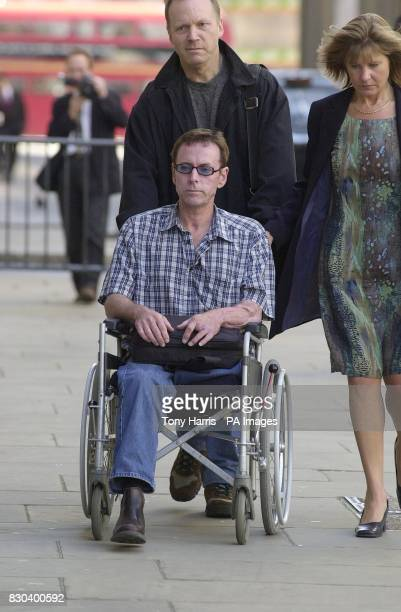 Gary Reid in a wheelchair who was injured in the Soho bomb attack in April 1999 arrives at the Old Bailey in London for the trial of nailbomber David...