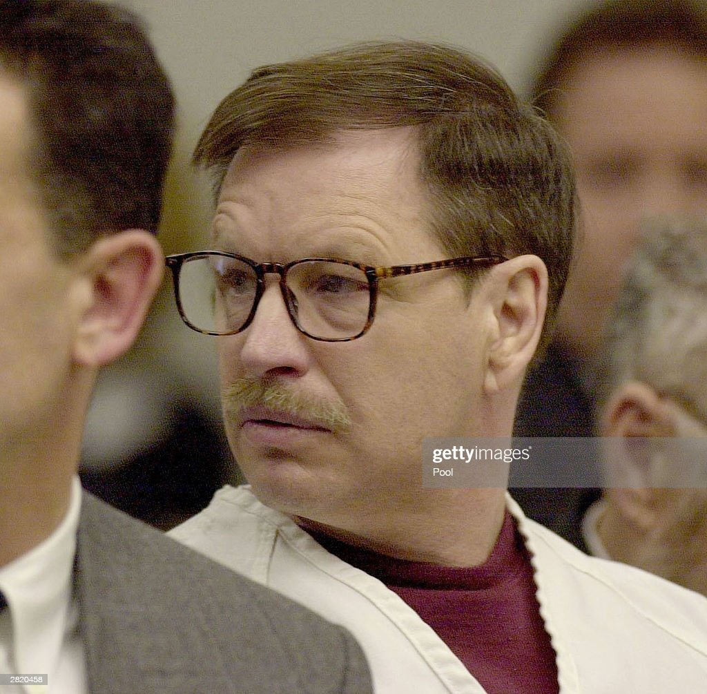 Gary Ridgway listens to a victim's family member address the court during the sentencing portion of his trial December18, 2003 in Seattle, Washington. Ridgway recieved a life sentence, with out the possibility of parole, for killing 48 women over the past 20 years in the Green River Killer serial murder case.