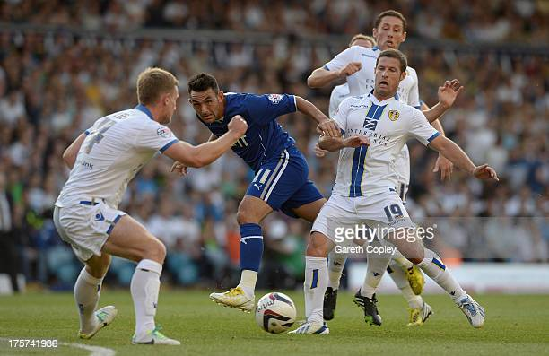 Gary Roberts of Chesterfield gets a shot past David Norris and Aidan White of Leeds during the Capital One Cup First Round match between Leeds United...
