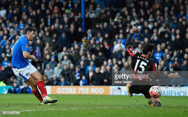 Gary Roberts of Portsmouth scores his team's first goal during the Emirates FA Cup Fourth Round match between Portsmouth and AFC Bournemouth at...