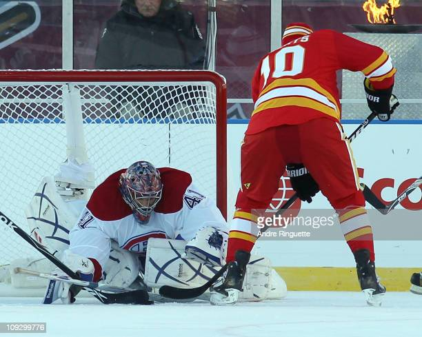 Gary Roberts of the Calgary Flames Alumni is stopped by Eric Fichaud of the Montreal Canadiens Alumni during the Alumni game held as part of the 2011...