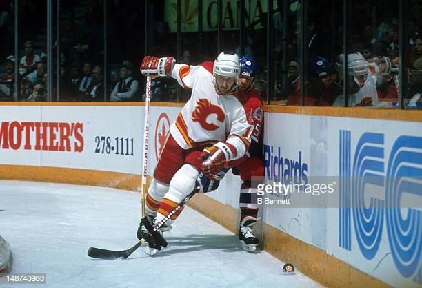 Gary Roberts of the Calgary Flames checks Bobby Smith of the Montreal Canadiens during the 1989 Stanley Cup Finals in May 1989 at the Olympic...