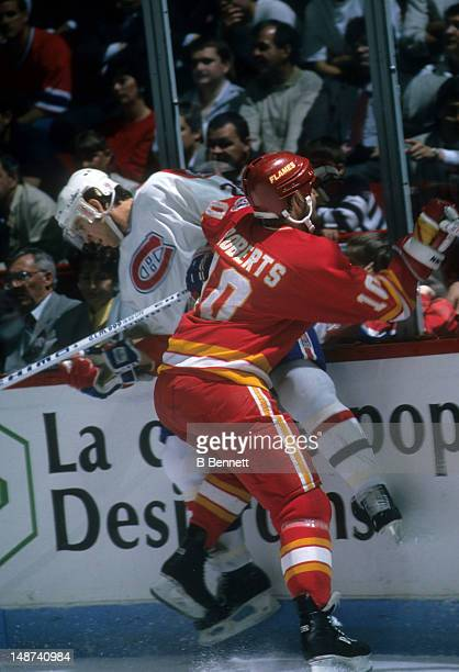 Gary Roberts of the Calgary Flames checks Eric Desjardins of the Montreal Canadiens during the 1989 Stanley Cup Finals in May 1989 at the Montreal...