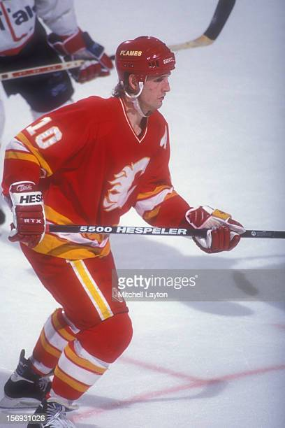 Gary Roberts of the Calgary Flames looks on during a hockey game against the Washington Capitals on March 6 1994 at the USAir Arena in Landover...