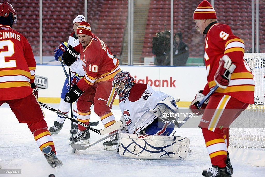 Gary Roberts #10 of the Calgary Flames skates against Eric Fishaud #41 of the Montreal Canadiens during the 2011 Heritage Classic Alumni Game on February 19, 2011 at McMahon Stadium in Calgary, Alberta, Canada.