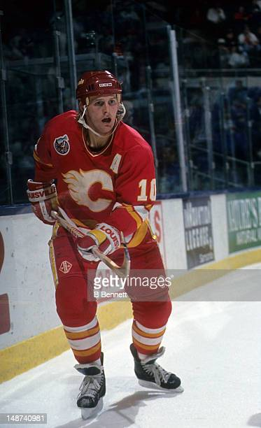 Gary Roberts of the Calgary Flames skates on the ice during an NHL game against the New York Islanders on January 12 1993 at the Nassau Coliseum in...