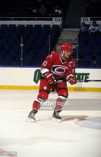 Gary Roberts of the Carolina Hurricanes skates on the ice during an NHL preseason game against the New York Islanders in September 1997 at the Nassau...