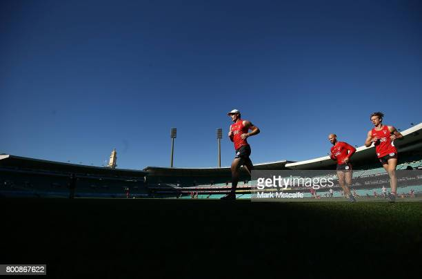 Gary Rohan of the Swans and Jarrad McVeigh of the Swans run during a Sydney Swans AFL training session at Sydney Cricket Ground on June 26 2017 in...