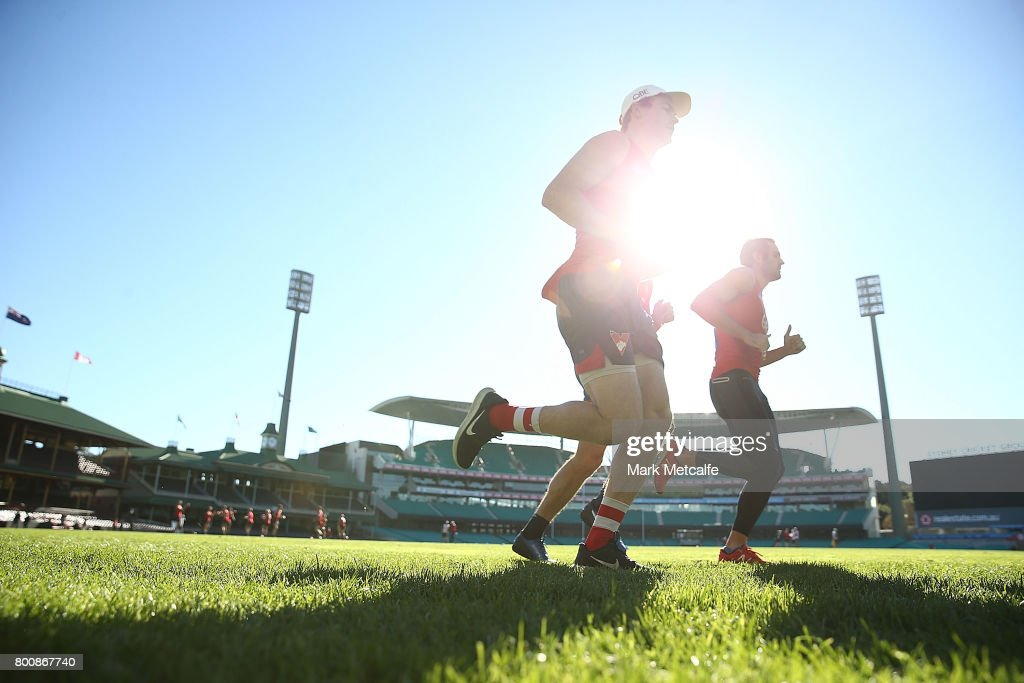 Gary Rohan of the Swans and Josh Kennedy of the Swans run during a Sydney Swans AFL training session at Sydney Cricket Ground on June 26, 2017 in Sydney, Australia.