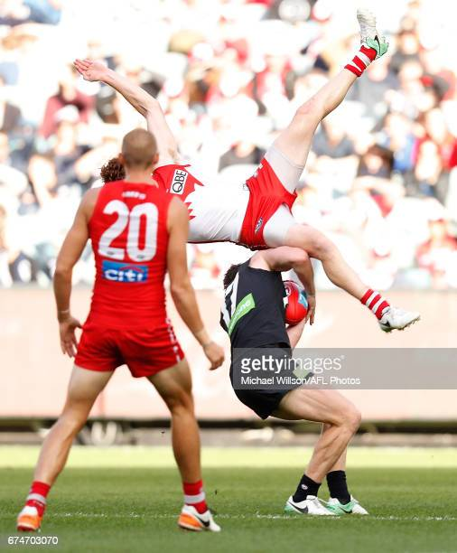 Gary Rohan of the Swans and Sam Rowe of the Blues collide during the 2017 AFL round 06 match between the Carlton Blues and the Sydney Swans at the...