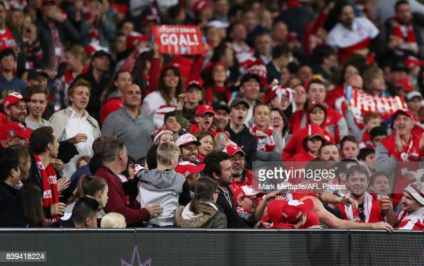 Gary Rohan of the Swans emerges from the crowd after kicking a goal during the round 23 AFL match between the Sydney Swans and the Carlton Blues at...