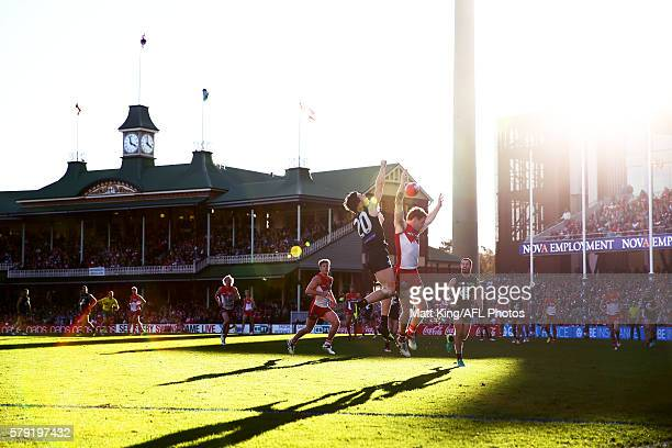 Gary Rohan of the Swans is challenged by Lachie Plowman of the Blues during the round 18 AFL match between the Sydney Swans and the Carlton Blues at...