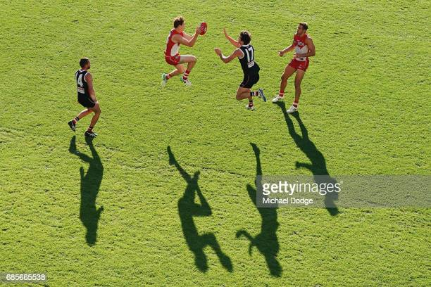 Gary Rohan of the Swans marks the ball against Dylan Roberton of the Saints during the round nine AFL match between the St Kilda Saints and the...