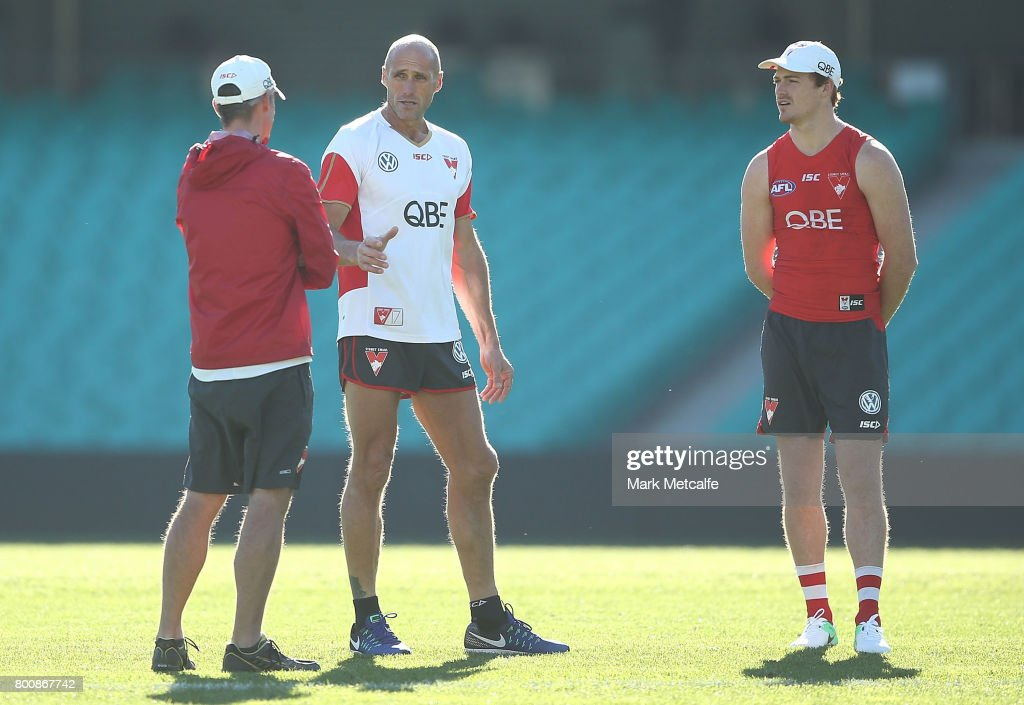 Gary Rohan of the Swans talks to Swans trainer Tony Lockett during a Sydney Swans AFL training session at Sydney Cricket Ground on June 26, 2017 in Sydney, Australia.