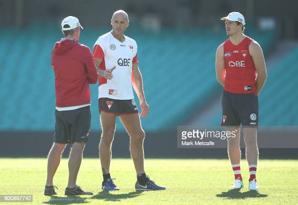 Gary Rohan of the Swans talks to Swans trainer Tony Lockett during a Sydney Swans AFL training session at Sydney Cricket Ground on June 26 2017 in...
