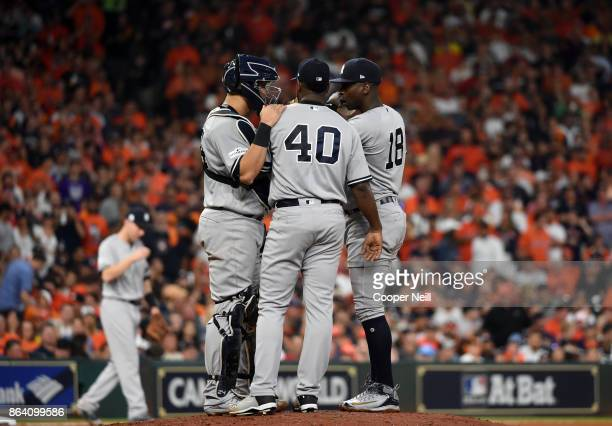 Gary Sanchez and Didi Gregorius of the New York Yankees visit starting pitcher Luis Severino on the mound during Game 6 of the American League...