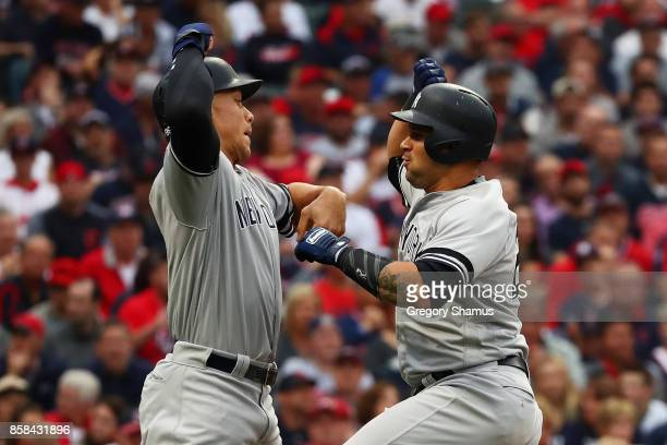 Gary Sanchez celebrates his tworun home run Aaron Judge of the New York Yankees first inning against the Cleveland Indians with during game two of...
