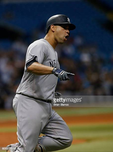 Gary Sanchez of the New York Yankees celebrates as he rounds the bases after hitting a threerun home run off of pitcher Brad Boxberger of the Tampa...
