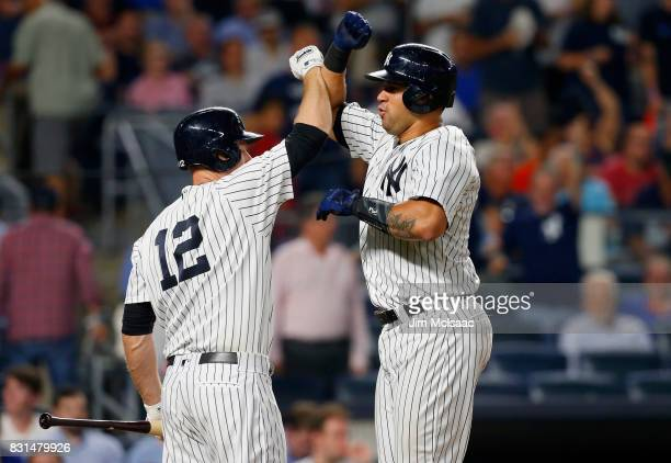 Gary Sanchez of the New York Yankees celebrates his eighth inning home run against the New York Mets with teammate Chase Headley at Yankee Stadium on...