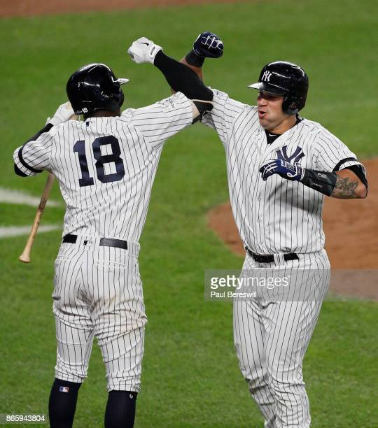 Gary Sanchez of the New York Yankees celebrates his home run with teammate Didi Gregorius in the seventh inning of game 5 of the American League...