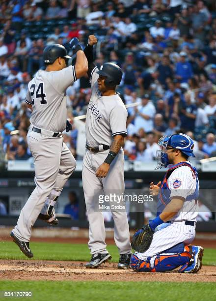 Gary Sanchez of the New York Yankees celebrates with Aaron Hicks after hitting a first inning 3run home run against the New York Mets at Citi Field...