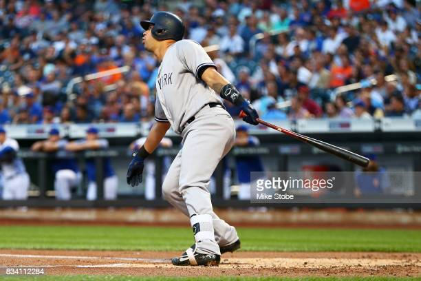 Gary Sanchez of the New York Yankees connects on a first inning 3run home run against the New York Mets at Citi Field on August 17 2017 in the...
