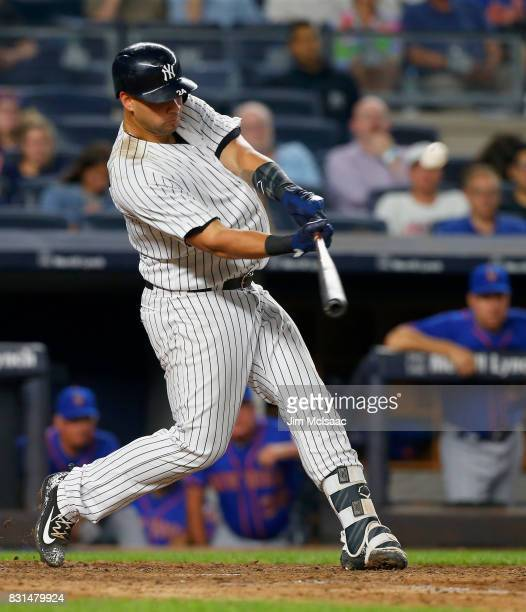 Gary Sanchez of the New York Yankees connects on an eighth inning home run against the New York Mets at Yankee Stadium on August 14 2017 in the Bronx...