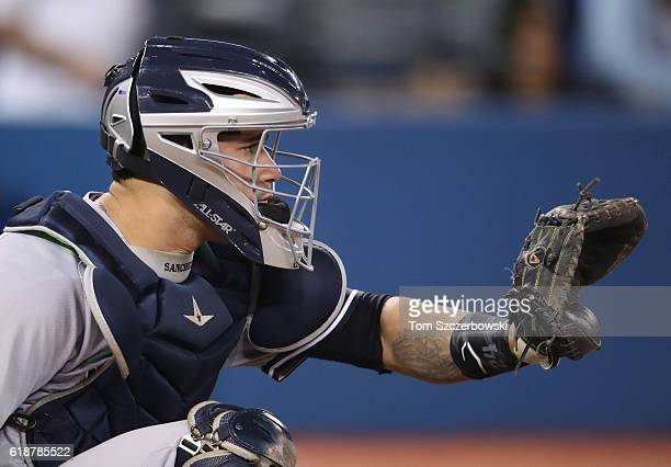 Gary Sanchez of the New York Yankees crouches behind home plate as he catches during MLB game action against the Toronto Blue Jays on September 26...