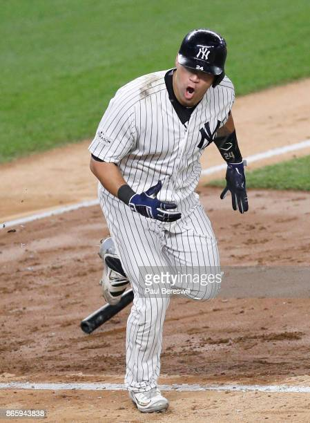 Gary Sanchez of the New York Yankees drops his bat to head to first base with an RBI single in the fifth inning of game 5 of the American League...