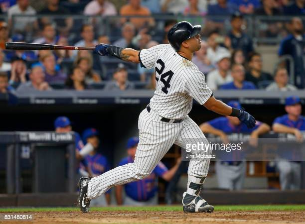 Gary Sanchez of the New York Yankees follows through on a fourth inning runscoring sacrifice fly against the New York Mets at Yankee Stadium on...
