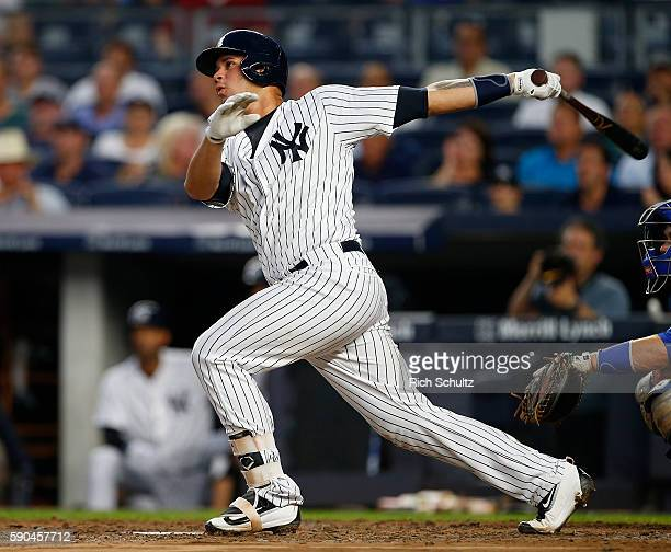 Gary Sanchez of the New York Yankees hits a home run against the Toronto Blue Jays during the second inning of a game at Yankee Stadium on August 16...