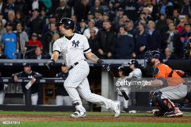 Gary Sanchez of the New York Yankees hits a sacrifice fly during the seventh inning against the Houston Astros in Game Four of the American League...