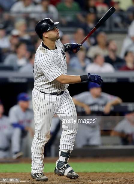 Gary Sanchez of the New York Yankees hits a sacrifice fly in the eighth inning against the New York Mets during interleague play on August 15 2017 at...