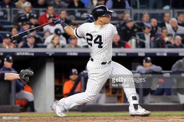Gary Sanchez of the New York Yankees hits a sacrifice fly in the seventh inning during Game 4 of the American League Championship Series against the...